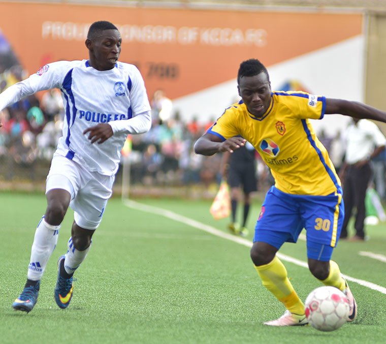 Muleme (R) dribbling past Police FC player