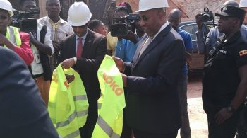 Ndugu Rugunda attempts to prepare the reflector jacket to slip it on