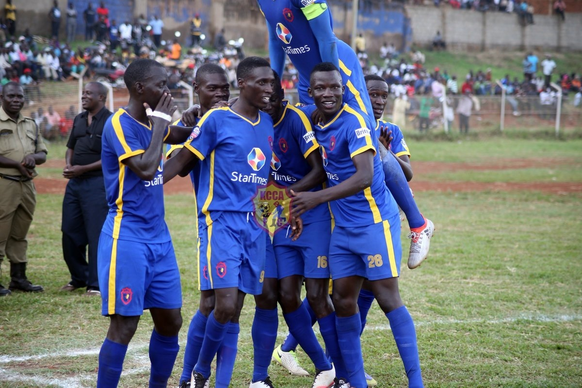 KCCA striker Nsibambi mobbed by colleagues in a recent league match continues to show signs of his goalscoring prowess but he is yet to explode